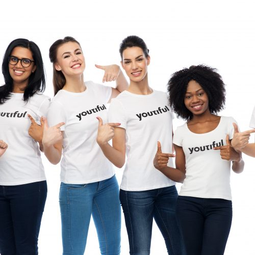 diversity, race, ethnicity and people concept - international group of happy smiling different women pointing to white blank t-shirts